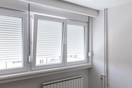 PVC window in white room Foto de archivo