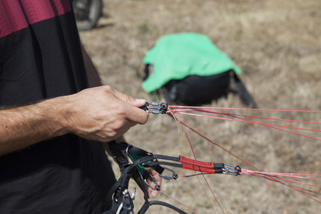 pilot checks his paraglider before take-off