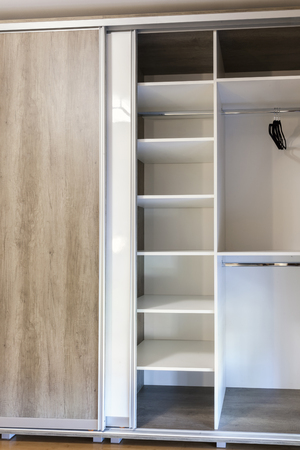 kitchen cabinets: open wooden drawers in the closet, close up
