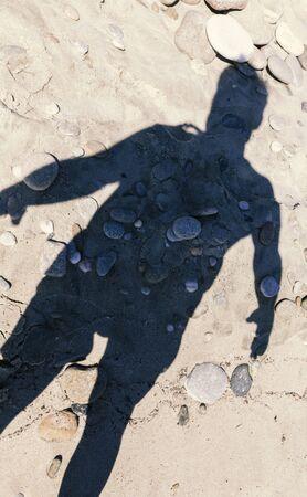 man shadow on the beach, stone organs