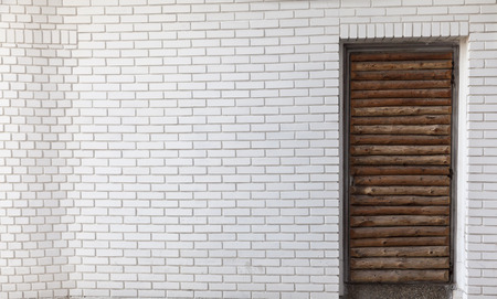 white brick wall with wooden door Stock Photo