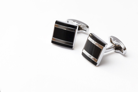 cufflinks silver on white backgrounds, close up