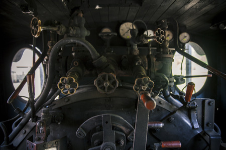 Controls of a vintage steam locomotive, boiler and gauges