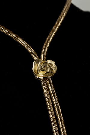 gold necklace on a brown background, close up