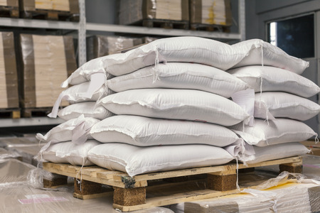 Sacks of flour on pallets in warehouse