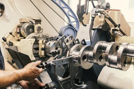 machining of engine parts, grinding crankshafts Stock Photo