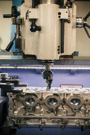 grinding cylinder head and valve seats Stock Photo