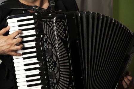 man play the accordion, close up Banco de Imagens