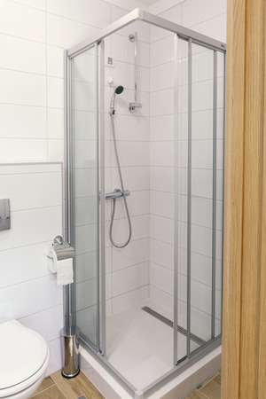 small glass shower in the bathroom
