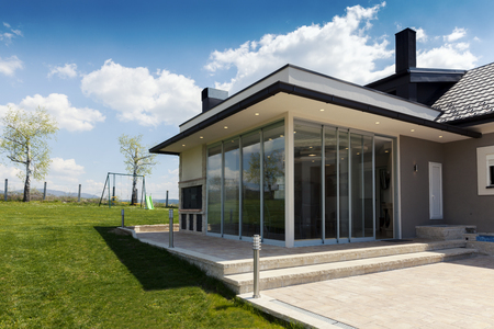 glazed terrace in the countryside with sliding glass Stockfoto