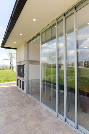glazed terrace in the countryside with sliding glass