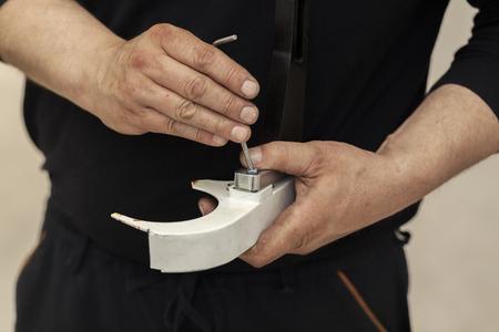 assembling metal parts, close up Reklamní fotografie