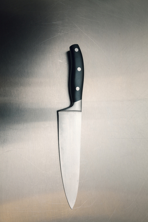 kitchen knife on a metal surface, close up