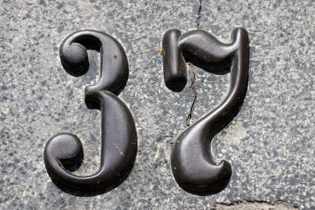 House numbers in different styles and colors (concept for real estate) photo