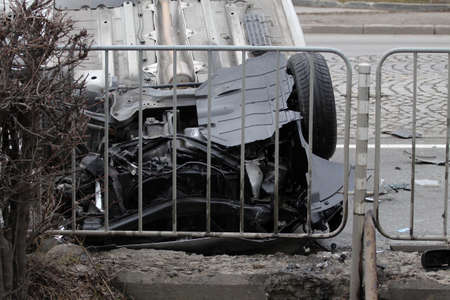 emergency lane: Car turned upside-down after road collision
