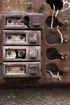 intercom: Rust intercom in close up on a brick wall