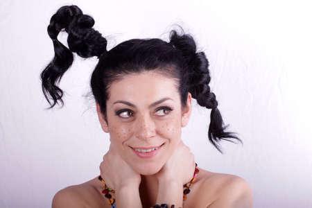 dishevel: Beautiful brunette woman with beauty long curly hair. Fashion model Stock Photo