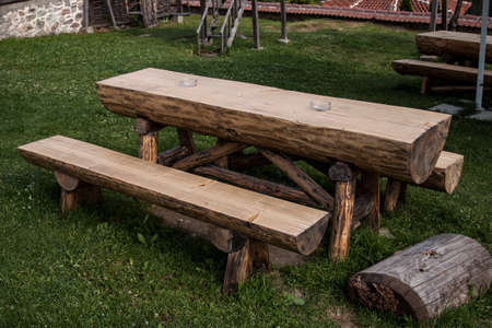 green meadows: Garden wooden table and bench isolated in the green meadows Stock Photo