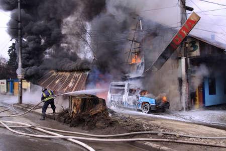 handcarves: Sofia, Bulgaria - February 18, 2011: Sofia, Bulgaria -  Firefighter extinguish a burning car on city, Sofia, Bulgaria