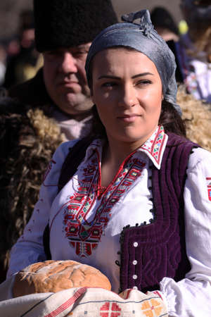 customs and celebrations: Bulgaria - jan 31, 2015: Woman in traditional masquerade costume is seen at the the International Festival of the Masquerade Games Surva in Pernik, Bulgaria. Photo taken on: January 31th, 2015 Editorial