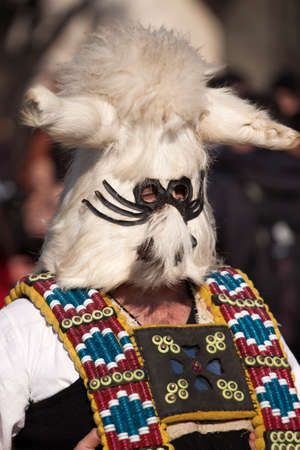 bul: Pernik, Bulgaria - January 30, 2016: Unidentified boy with traditional Kukeri costume are seen at the Festival of the Masquerade Games Surva in Pernik, Bulgaria. Surva takes place the third weekend of January and its the biggest event of this type in Bul