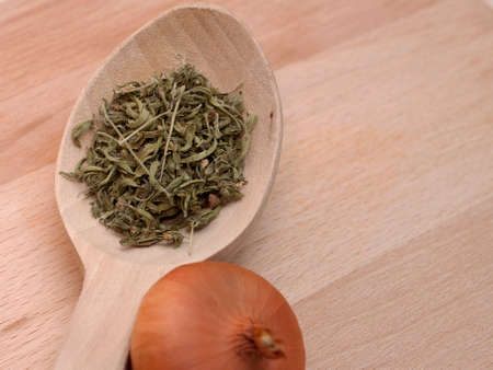 traditonal: Traditonal wooden spoon with onion and savory