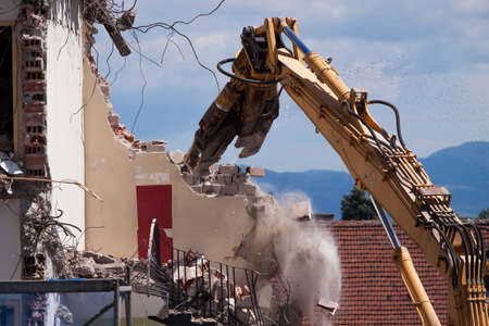 deconstruct: Demolition of building, Buildings with heavy industrial machine