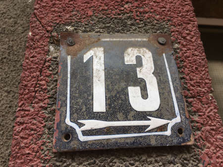metal: Vintage grunge square metal rusty plate of number of street address with number closeup