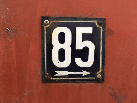grunge: Vintage grunge square metal rusty plate of number of street address with number closeup