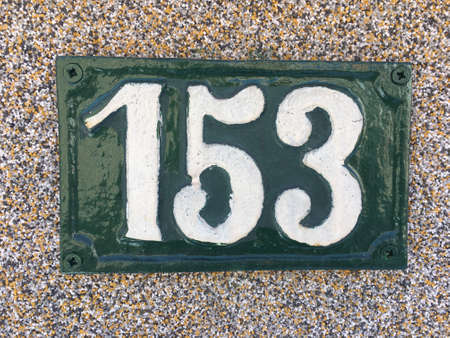 Vintage grunge square metal rusty plate of number of street address