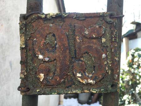 grunge: Vintage grunge square metal rusty plate of number of street address
