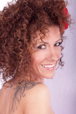 Beauty portrait of beautiful woman. Hairstyle with curly hair. Stock Photo