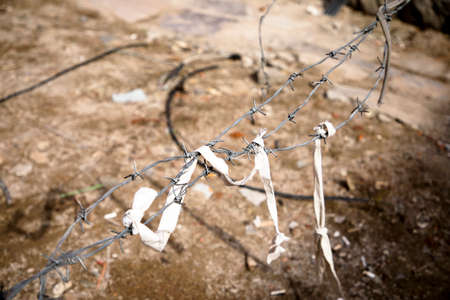 Barbed wire on a brown background, Barbed wire on abstract background