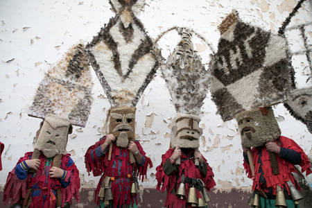 Zenen, Bulgaria - March 16, 2019: Masquerade festival in Zemen, Bulgaria. People with mask called Kukeri dance and perform to scare the evil spirits.  Photo taken on: March 16th, 2019