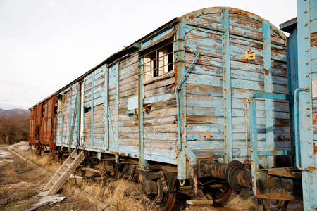 Abandoned old railway wagons at station, old train wagons in an abandoned station