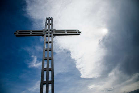 A Christian cross, a background of clouds and sunshine, a beautiful mysterious background