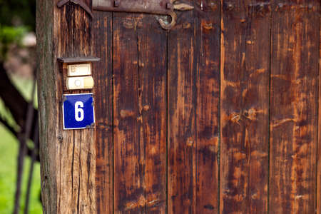 Old, rusty house number plate, old house number, street number