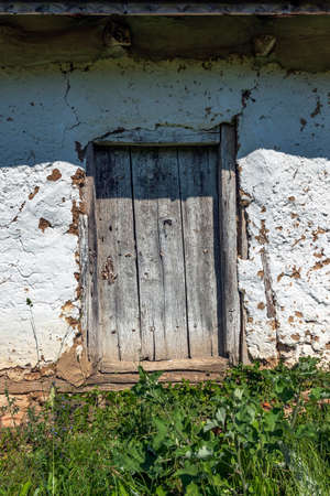Front view of the door of an abandoned old house. 写真素材