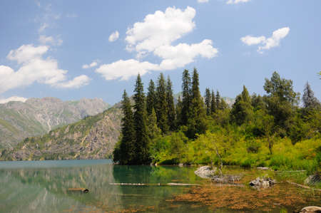 dean lake: Colorful Sary-Chelek Lake with mountains, sky and clouds