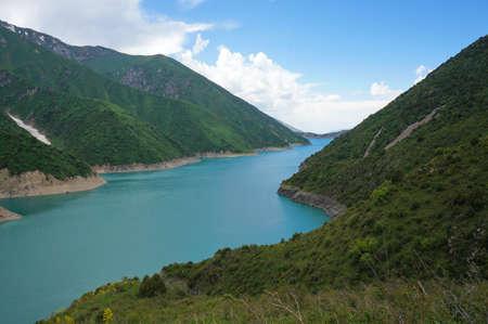 long lake: Long lake among high charming mountains and blue sky in Kyrgyzstan