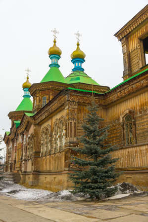 Holy Trinity Cathedral. Old wooden Russian Orthodox Church in Karakol, Kyrgyzstan Stock Photo