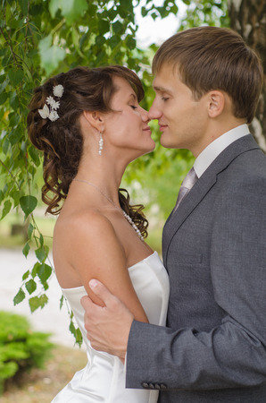 Young wedding couple kissing  Romantic portrait  photo