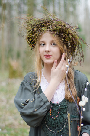 circlet: Portrait of a girl in a folk  medieval style with a circlet of flowers touching her face
