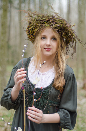 circlet: Portrait of a girl in a folk  medieval style with a circlet of flowers touching willow branch