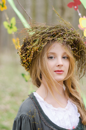 circlet: Close up portrait of a pretty pensive girl in a folk   circlet of flowers Stock Photo
