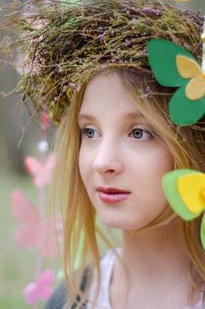 circlet: Close up portrait of a folk style beautiful girl in a circlet of flowers Stock Photo