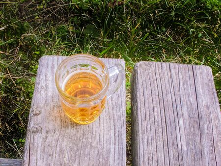 picknic: A mug of beer on a bench, in Stuttgart park