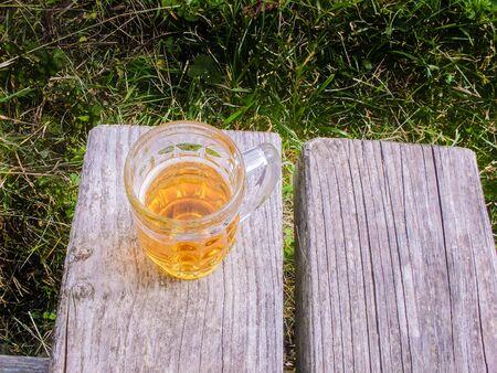 picknic: A mug of beer on a bench, in Stuttgart park