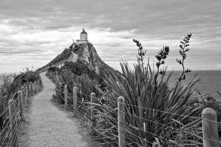 Black and white Kaka point lighthouse in New Zealand Stock fotó