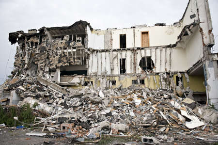 Destroyed building, can be used as demolition, earthquake, bomb, terrorist attack or natural disaster concept. Series photo
